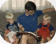 My husband reading to the kids when they were little (1993).